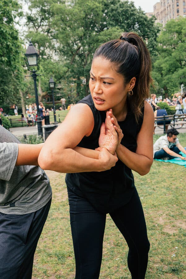 The author traps her partner in a two-handed wrist lock.